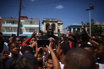 Former NBA basketball star Shaquille O'Neal poses for photos after conducting a master class for young people in Havana