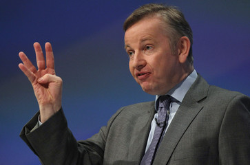 Britain's Education Secretary Gove gestures during his keynote address on the third day of the Conservative Party Conference in Manchester