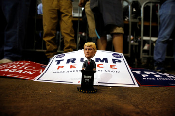Supporters display a bobblehead doll as they gather at the start of a rally with U.S. Republican presidential nominee Donald Trump in Delaware