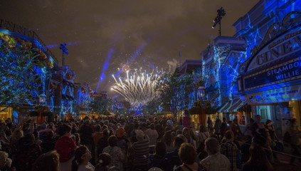 People watch a fireworks show on Main St at Disneyland in Anaheim