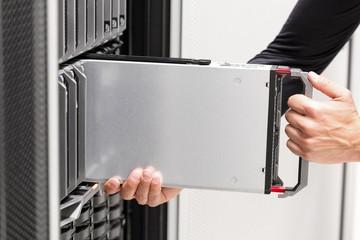 IT professional installs server cluster in large datacenter