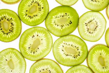 Bright sweet kiwi slices on white