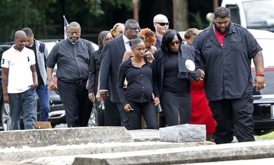 Sandra Sterling walks with her daughter Crystal Egbont and other family members and friends as they arrive for the burial of Alton Sterling at the Mount Pilgrim Benevolent Society Cemetery in Baton Rouge