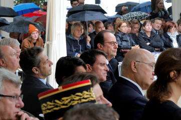 French President Hollande, Prime Minister Valls and former French President Sarkozy listen to speeches during a ceremony for victims of terror attacks in Paris