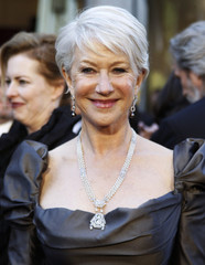 Actress Helen Mirren smiles as she arrives to present the 83rd Academy Awards in Hollywood