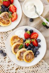 Cottage cheese quark pancakes syrniki with fresh berries
