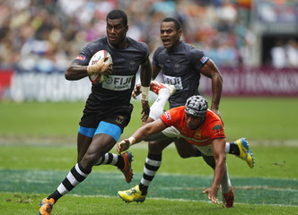 Fiji's Saqiwa is tackled by Sri Lanka's Rajapaksa during the second day of the three-day Hong Kong Sevens rugby tournament