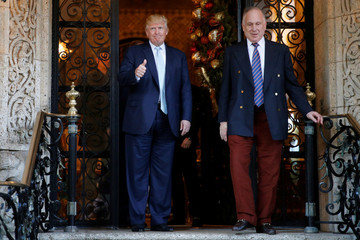 Trump sees out Lauder after their meeting at the Mar-a-lago Club in Palm Beach, Florida