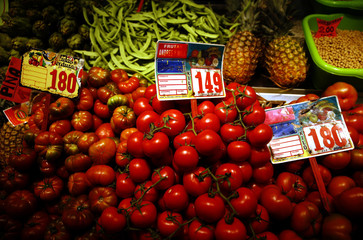 Fresh produce is seen at a produce stand at a market in central Madrid
