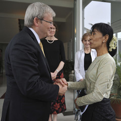 Australia's Foreign Minister Rudd shakes hands with Myanmar democracy icon Aung San Su Kyi after their meeting at the Australian ambassador's Residence in Yangon