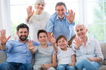 Happy family waving hands