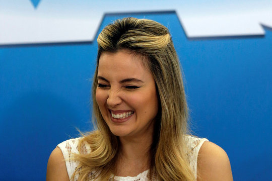 First lady Marcela Temer smiles during a launch ceremony of the Happy Child Program at the Planalto Palace in Brasilia