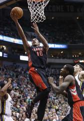 Toronto Raptors guard DeMar DeRozan drives for a shot against the Utah Jazz during the first half of their NBA basketball game in Salt Lake City, Utah