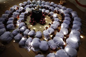 Novice nuns pray at the Sathira-Dhammasathan Buddhist meditation centre in Bangkok