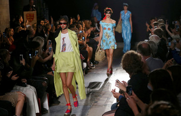 Models present creations at the PPQ catwalk show during London Fashion Week Spring/Summer 2017 in London,