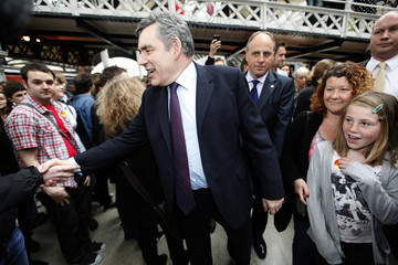 Britain's Prime Minister Gordon Brown greets people as he arrives to campaign in Newcastle