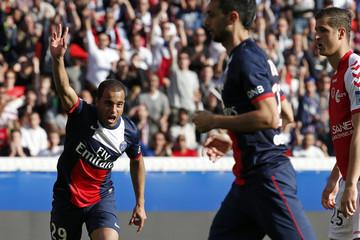 Paris St Germain's Lucas celebrates after scoring a goal against Stade de Reims during their French Ligue 1 soccer match at the Parc des Princes Stadium in Paris