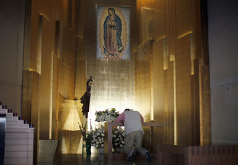 Paradox prays in front of the Virgin of Guadalupe after learning of the newly elected Pope Francis at the Cathedral of Our Lady of the Angels in Los Angeles, California