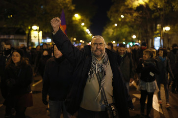 Protester shouts slogans during a protest against a new security reform in Madrid