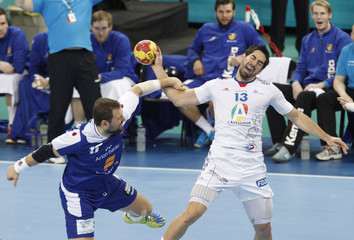 France's Nikola Karabati attempts to score against Iceland's Sverre Jakobsson during World Men's Handball Championship at Palau Sant Jordi arena in Barcelona