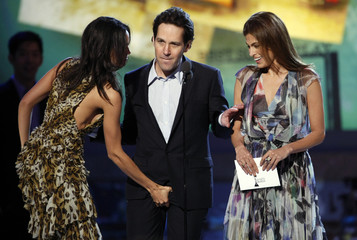 Rosario Dawson grabs the crotch of Paul Rudd after Rudd grabbed the breast of Eva Mendes while they were presenting the Best Screenplay award at the Film Independent Spirit Awards in Santa Monica