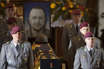 Soldiers stand beside the coffin of a German soldier killed in Afghanistan, during funeral services at the St. Lamberti Church in Selsingen