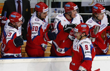 Russia's Alexander Ovechkin celebrates with team mates after scoring a goal against Sweden during their Channel One Cup ice hockey game in Moscow