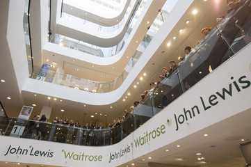 John Lewis and Waitrose employees wait for the announcement of their 2015 bonus in central London