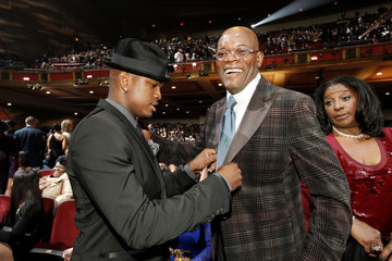 Ne-Yo jokingly fixes the coat of Jackson, as Jackson's wife LaTanya stands nearby, at the 43rd annual NAACP Image Awards at the Shrine auditorium in Los Angeles