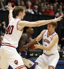 Indiana Hoosiers' Zeller and Hulls pressure James Madison Dukes' Nation during NCAA tournament basketball game in Dayton