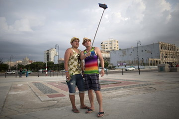Tourist Sergio Morcoso, 28, from Bolivia, poses for a photo with his friend Yusinel Morales, 30, from Cuba, in Havana