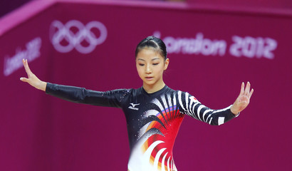 Asuka Teramoto of Japan competes in the balance beam during the women's gymnastics qualification in London