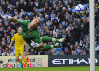 Notts County's Hawley shoots past Manchester City's Hart hitting the post during their FA Cup soccer match at Manchester