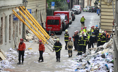 Rescue workers and firefighters search the area after an explosion in Prague