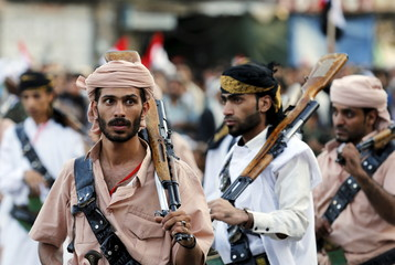 Houthi followers take part in a ceremony marking the first anniversary of the Houthi movement's takeover of Yemen's capital Sanaa