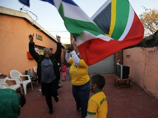 The extended Raymond family and their friends cheer after South Africa scored against France in Pretoria