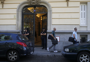 UDEF tax investigators carry items retrieved from the headquarters of Spanish wireless networks provider Gowex during a search ordered by a Spanish judge in downtown Madrid