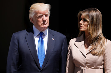 U.S. President Trump and first lady Melania Trump wait the arrival of French President Macron before a lunch ahead of a NATO Summit in Brussels