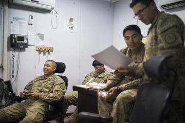 U.S. soldiers from the 3rd Cavalry Regiment play video games after returning from a mission at FOB Gamberi in the Laghman province of Afghanistan