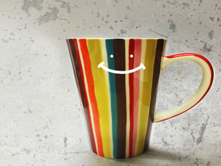 Colorful smile coffee cup on grunge background