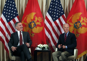 U.S. Vice President Biden meets Montenegro's Prime Minister Djukanovic during the 51st Munich Security Conference in Munich