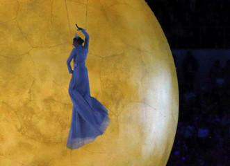 Performer suspended in mid-air takes part in the closing ceremony of the 2014 Sochi Winter Olympics