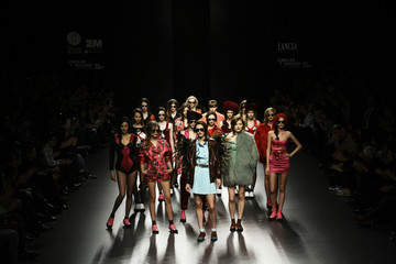 Models display creations by designer Escote during the Cibeles Madrid Fashion Week Fall/Winter 2010 show in Madrid
