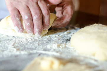 old woman's hand monthly dough
