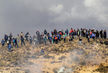 Independent miners are seen during a clash with riot policemen during a protest against Bolivia's President Evo Morales' government policies, in Mantecani