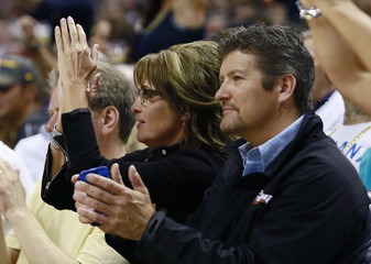 Former U.S. Republican vice-presidential candidate Sarah Palin and her husband Todd take in Game 3 of the NBA Eastern Conference final basketball playoff series between the Heat and the Pacers in Indianapolis