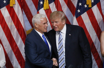 Republican U.S. presidential candidate Trump chats with Indiana Governor Pence after Trump introduced Pence as his vice presidential running mate in New York City