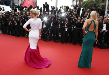 """Model Hofit Golan poses on the red carpet as she arrives for the screening of the film """"Mad Max: Fury Road"""" out of competition at the 68th Cannes Film Festival in Cannes"""