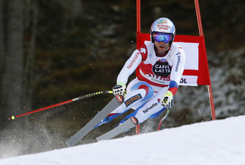 Defago of Switzerland clears a gate during the men's World Cup Downhill skiing race in Val Gardena