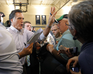Republican presidential candidate Romney greets audience members in Exeter